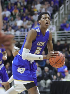Grand Rapids CC center Marcus Bingham Jr. takes a shot against New Haven during the first quarter of the Class B MHSAA semifinals Friday in East Lansing.