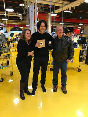 Third Man Records founder Jack White, center, with Denise and Dan Zieja, owners of Melodies & Memories in Eastpointe.