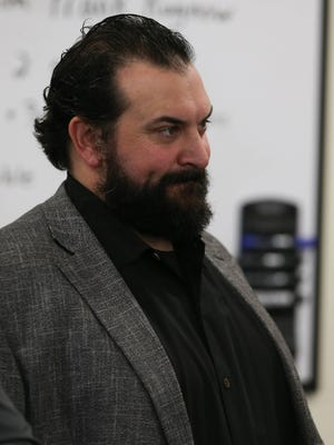 Lions coach Matt Patricia listens as first-round draft pick Frank Ragnow talks to reporters on Friday, April 27, 2018, in Allen Park.