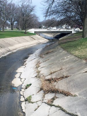 Cracked and broken concrete bed of the Kinnickinnic River at Pulaski Park will be removed this year as part of an $8.6 million flood control project that will include widening the channel west of S. 16th St.