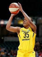 Indiana Fever guard Victoria Vivians (35) puts up a three-point attempt in the first half of their WNBA preseason basketball game at Bankers Life Fieldhouse on Monday, May 7, 2018.