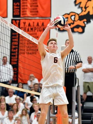 Northeastern's Austin Richards sets the ball against Central York in the fourth set of a YAIAA boys' volleyball match Thursday, May 10, 2018, at Northeastern. Northeastern defeated Central 3-2 (20-25, 21-25, 25-16, 25-14, 15-7) to win the regular-season YAIAA title.