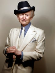 Author Tom Wolfe in 2012. He was known for his sartorial