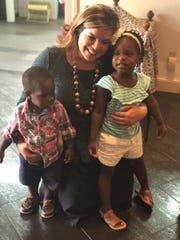 RMHC Volunteer Manager Illeny Farese with Eli and Zoe.