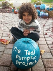 Elias Habib, 4, of Rochester painted pumpkins teal as part of a food-allergy awareness campaign called the Teal Pumpkin Project. His family will display the pumpkin and pass out nonfood treats this Halloween.