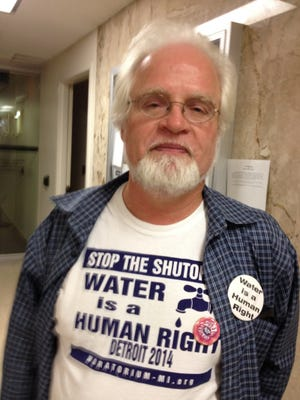 Retired steelworker Pat Driscoll, 64, of Detroit was one of about two dozen people at today's Detroit City Council meeting to protest a proposed plan to regionalize the Detroit Water and Sewerage Department.