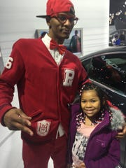 James Griffin, 31, of Detroit, walked around with his daughter Naim, 6, at the 2015 North American International Auto Show in Detroit Monday, Jan 19, 2015. Griffin doesn't like the idea of 72 month or 84 month car loans.
