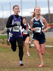Claire Lamb from Granville races down the straight away to place 12th in the DII state cross country meet Saturday at National Trail Raceway. The Granville girls team placed 1st in their race.