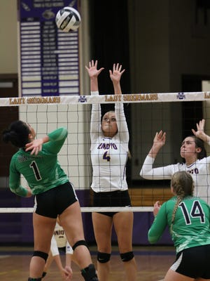 Unioto's Ashley Taylor attempts to block a kill attempt from Huntington's Rikki Magill during the third set of Tuesday's match at Unioto High School. Taylor's Shermans swept Magill's Huntsmen, 25-23, 25-11 and 25-21.
