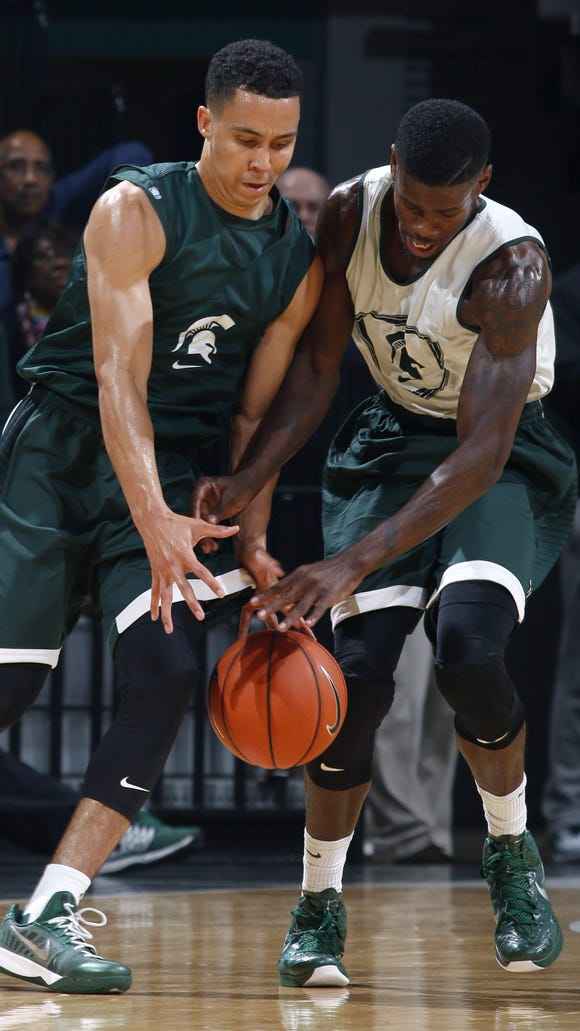 Eron Harris, right, steals the ball from Travis Trice during MSU's Midnight Madness scrimmage. Harris must sit out this season due to NCAA transfer regulations, but coach Tom Izzo said he will provide toughness and scoring when he is eligible in the 2015-16 season.