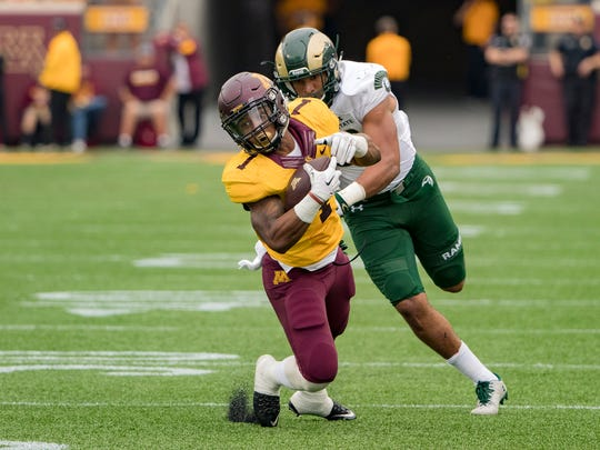 Sep 24, 2016; Minneapolis, MN, USA; Minnesota Golden Gophers running back Rodney Smith (1) falls to the ground and gets tackled from Colorado State Rams linebacker Kevin Davis (33) after catching the ball for a first down in the second half at TCF Bank Stadium. The Gophers won 31-24. Mandatory Credit: Jesse Johnson-USA TODAY Sports