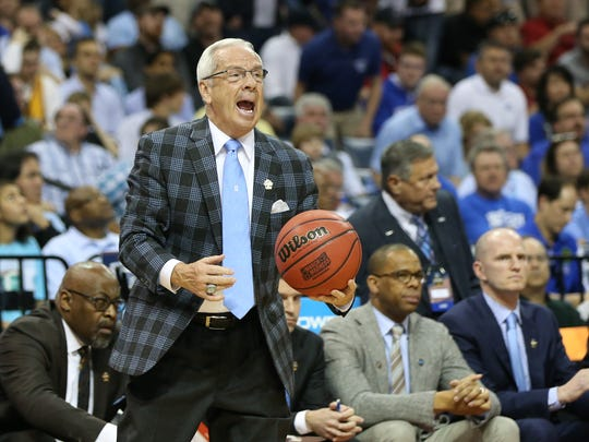 North Carolina Tar Heels head coach Roy Williams holds the ball in the second half against the Kentucky Wildcats during the finals of the South Regional of the 2017 NCAA Tournament at FedExForum.