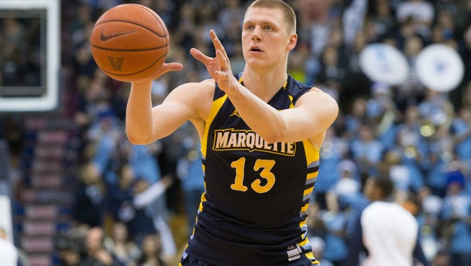 Marquette Golden Eagles forward Henry Ellenson (13) catches the ball before a foul shot against the Villanova Wildcats during the first half at The Pavilion. Villanova won 83-68.