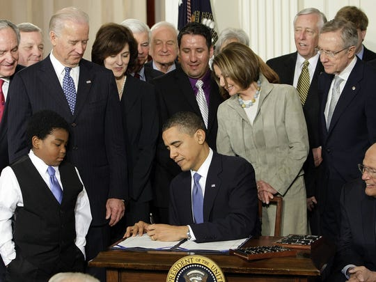 President Barack Obama signs the Affordable Care Act at the White House on March 23, 2010.