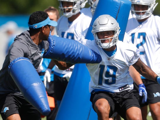 Detroit Lions receiver Kenny Golladay runs a drill