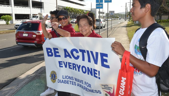 In this March 29 file photo, volunteers and supporters of the Guam Diabetes Association wave at the ITC intersection for diabetes awareness and prevention. Lions Club International Guam chapter will hold a wave for diabetes awareness from 4 p.m. to 6 p.m. Nov. 28 at the ITC intersection.