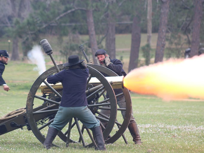 Union re-enactors brace for the blast of their cannon