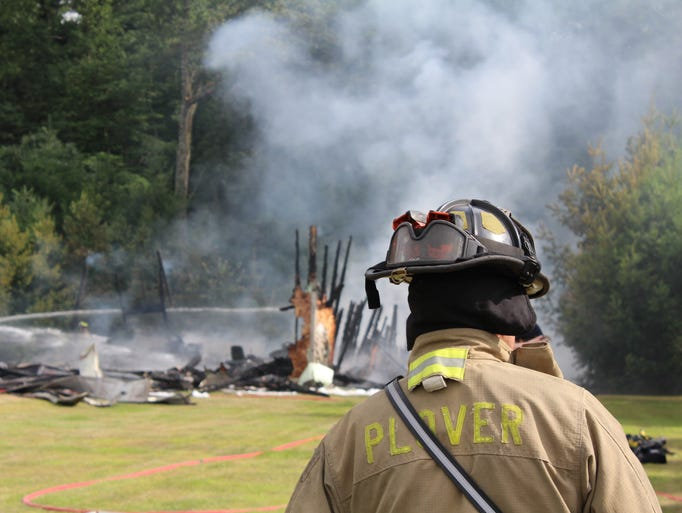 Firefighters respond to a garage fire Monday afternoon