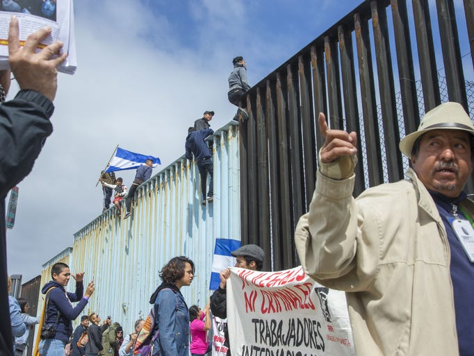 A Central American migrant group and supporters of