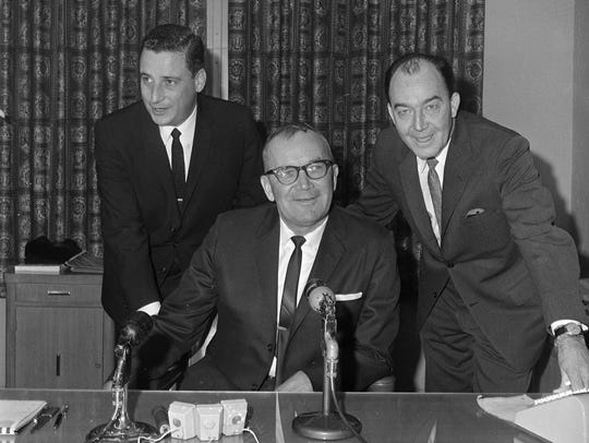 Blanton Collier is flanked by Arthur B. Modell, Cleveland