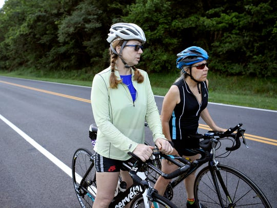 Franklin residents Belinda Leslie and Jenny Young ride their bikes on Natchez Trace Parkway in Franklin on July 10, 2017.