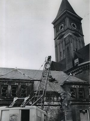 Demolition begins as a crew's wrecking ball batters the roof of the Chicago & North Western railway depot, at the foot of E. Wisconsin Ave., on April 3, 1968.