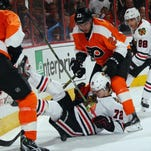 PHILADELPHIA, PA - OCTOBER 14: Artemi Panarin #72 of the Chicago Blackhawks is taken down by Brandon Manning #23 of the Philadelphia Flyers during the third period at the Wells Fargo Center on October 14, 2015 in Philadelphia, Pennsylvania. The Flyers defeated the Blackhawks 3-0. (Photo by Bruce Bennett/Getty Images)