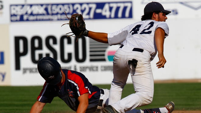 Top Tier's Jordan Libman, left, is tagged out at second base by Connecticut Bombers' Giovanni Torres on Saturday in Game 5 of the Connie Mack World Series at Ricketts Park in Farmington.