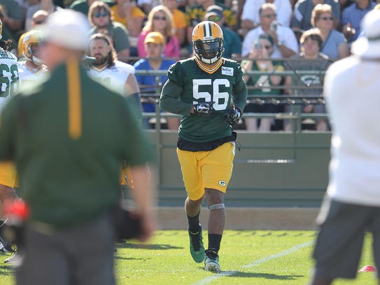 Linebacker Julius Peppers takes part in the opening