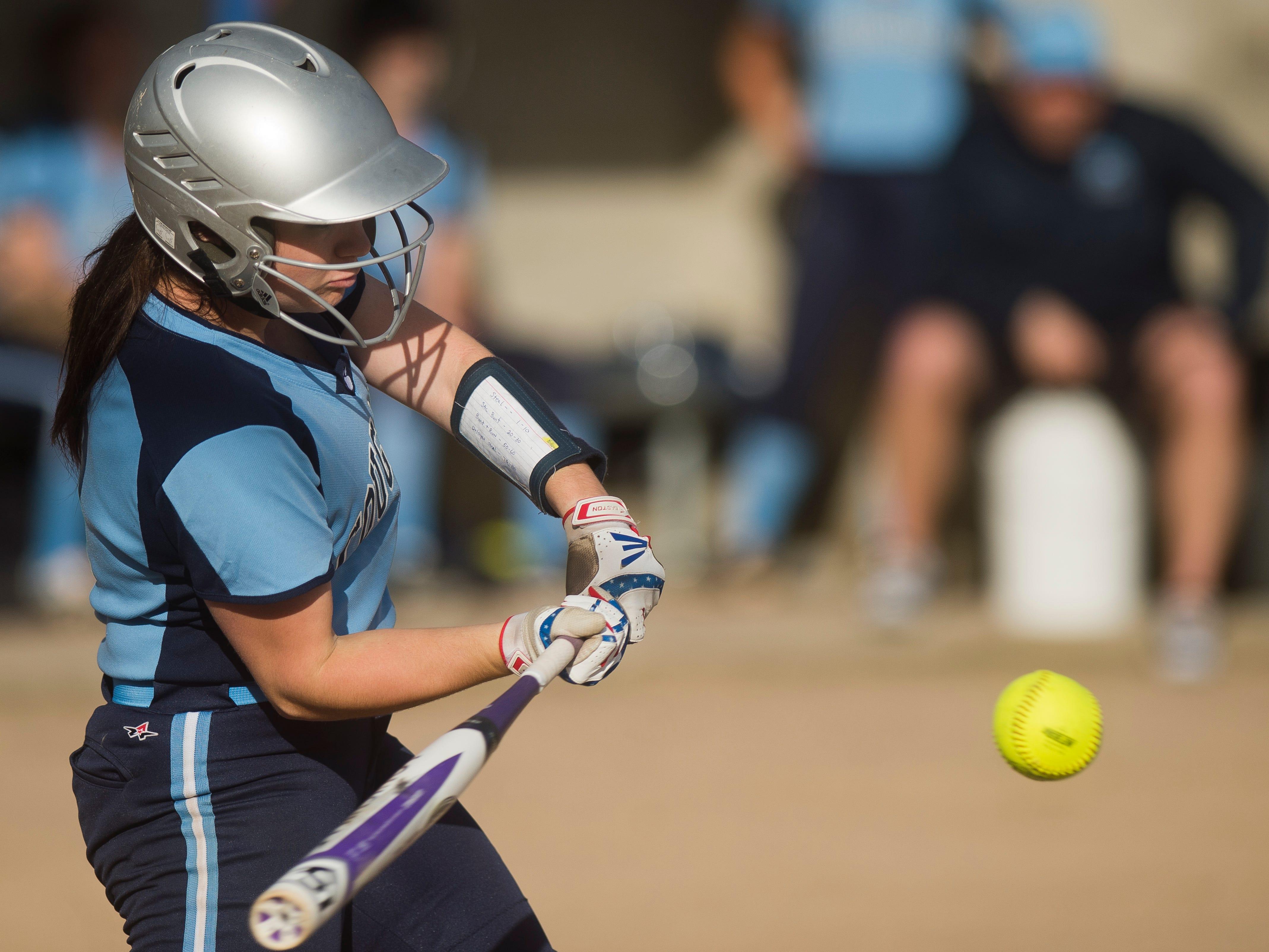 MMU's Sydney LeBourveau smashes a home run during a high school softballl game vs. Middlebury on Tuesday.