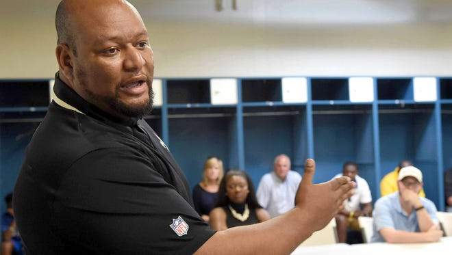 Former New Orleans Saints running back Deuce McAllister speaks to the Dandy Dozen athletes, coaches and parents after the photo shoot on Monday at Mississippi Veterans Memorial Stadium in Jackson. Before reaching the NFL, McAllister played for Ole Miss and Morton High School.