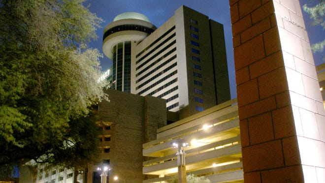 """The Hyatt Regency Hotel, with its """"flying saucer"""" Compass Room restaurant on top, is one of downtown Phoenix's most distinctive buildings."""
