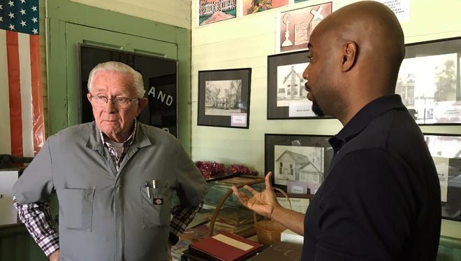 Evan Lewis of Chicago, right, talks with John Waggoner in April 2017 inside City Hall in Colbert, Ga. Lewis asked the former mayor if he knew any information related to his great-grandfather's lynching, which happened in 1936 in Colbert.