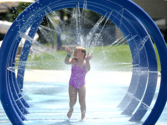 The Splash 'n' Blast water park at Kensington Metropark, which provided cooling relief and fun for a child during a hot spell in July 2016, is closed temporarily after an employee tested positive for COVID-19.