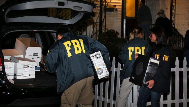 FBI agents remove evidence Oct. 10, 2013, from the Brooklyn, N.Y., residence of Rabbi Mendel Epstein during an investigation. Several defendants, including Epstein and another rabbi, were arrested in an overnight sting in New York and New Jersey and accused of plotting to kidnap and beat a man to force him to grant a religious divorce.