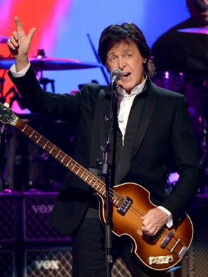Paul McCartney performs during the iHeartRadio Music Festival at the MGM Grand Garden Arena on Sept. 21 in Las Vegas.