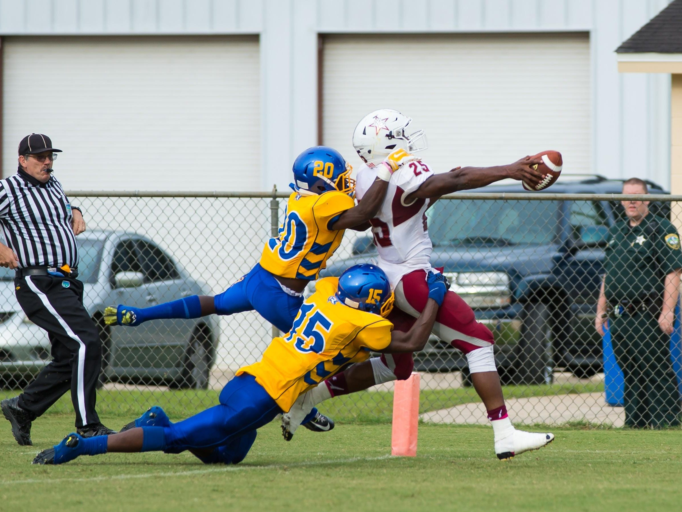 Madison running back Patrick Brown rips off a rushing touchdown even with Rickards defenders draped on his back.