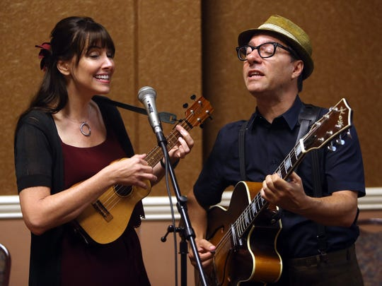 Erin McGrane and Jeff Freling of Kansas City, Missouri playing an original song as the duo 'Victor and Penny' during a workshop at the Folk Project's fourth annual ukulele festival at the Ukrainian American Cultural Center. August 27, 2016, Whippany, NJ