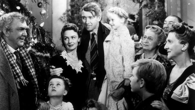"George Bailey (James Stewart, center) gets a little help from his friends, and an angel, in ""It's a Wonderful Life."""