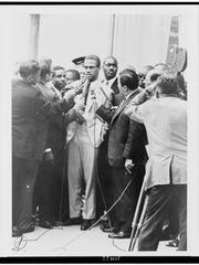 Malcolm X with reporters in 'I Am Not Your Negro,' a Magnolia Pictures release.