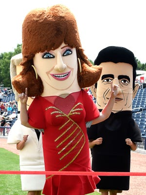"""Tennessean columnist Joe Rexrode, dressed as Reba McEntire, crosses the finish line first in the """"Country Legends Race"""" at the Nashville Sounds game Wednesday, June 1, 2016."""