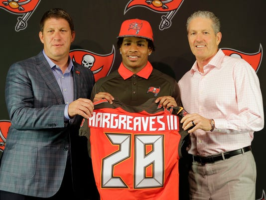 Tampa Bay Buccaneers first-round draft pick Vernon Hargreaves, center, poses with general manager Jason Licht, left, and head coach Dirk Koetter, right, during a news conference Friday, April 29, 2016, in Tampa, Fla. Hargreaves, formally of the University of Florida, was the 11th overall pick in the draft. (AP Photo/Chris O'Meara)