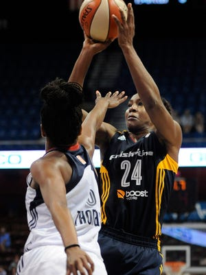 The Indiana Fever's Tamika Catchings shoots the game-winning basket as Connecticut 's Jasmine Thomas defends.