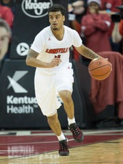 Quentin Snider brings the ball up the court during the U of L and UK basketball game at the KFC Yum Center on Wednesday night. Dec. 21, 2016