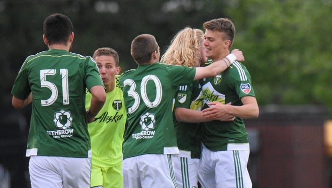 Francesco Amorosino is mobbed after scoring the first of two goals on the night for the Timbers U23s in their 2-0 victory over the TSS FC  Rovers on Tuesday, May 16, 2017 at McCulloch Stadium in Salem, Ore.
