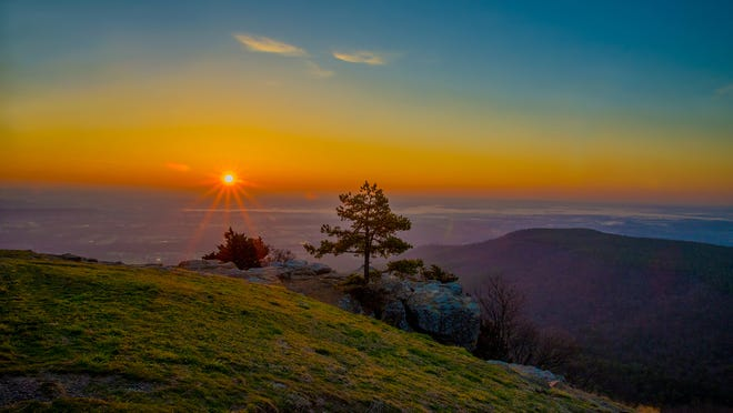 This photo was taken at sunrise on Mount Nebo, near Russellville, Ark. My husband and I used to live in Springfield (I'm originally from Monett) and we moved to the Fayetteville area about four years ago. We try to do as much exploring and enjoying of the great natural state as we can. Arkansas has some impressive mountain peaks but until the weekend I took this photo, we hadn't really checked them out. We decided we wanted to be able to compare some of them with each other so we visited three peaks in one weekend — Mount Nebo, Petit Jean Mountain, and Mount Magazine (the highest point in Arkansas). They were all amazing, but Mount Nebo was definitely my favorite. — Lindsay Watt, Elkins, Ark.
