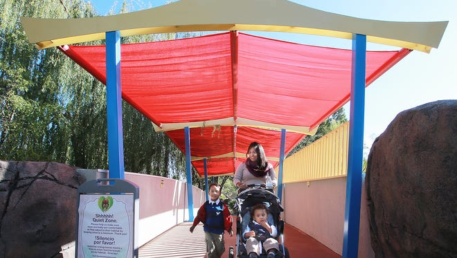 Tiffany Henley and children Bryston and Braden made their way beneath a tent shade next to the elephant exhibit at the El Paso Zoo Sunday. The shade is one of the improvements made with with 2012 quality of life bond.