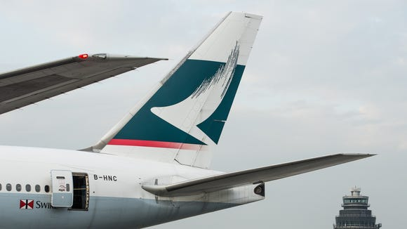 A Cathay Pacific plane sits on the tarmac of Hong Kong
