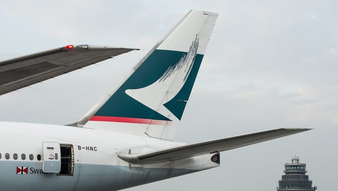 A Cathay Pacific plane sits on the tarmac of Hong Kong International Airport on  Dec. 7, 2012.