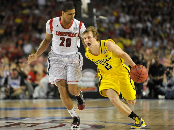 Michigan guard Spike Albrecht rushes the ball up the